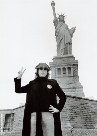 John Lennon making a visit to have his picture taken in front of the statue of Liberty!